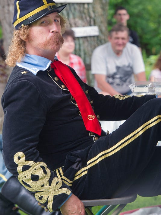 "Steve Alexander, of Monroe Michigan, portrays George Armstrong Custer during the Hunterstown  Battle Commemoration 150th event Tuesday July 2, 2013 in Straban Township. Behind him is a ""witness tree"" that was around during the Civil War.    PAUL KUEHNEL - YORK DAILY RECORD/SUNDAY NEWS"