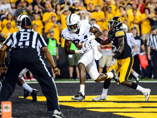 Penn State's Juwan Johnson (84) catches the game winning touchdown at Kinnick Stadium on Saturday. Johnson juked safety Miles Taylor (not pictured) and Trace McSorley threw a perfect pass.