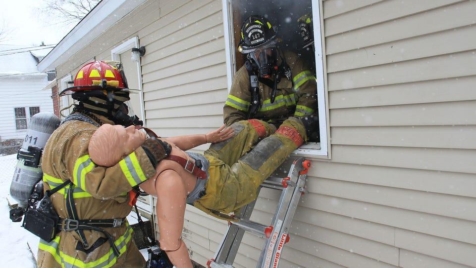 Iowa City firefighters Bill Schmooke, left, and Larry