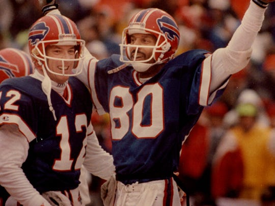 Jim Kelly and James Lofton celebrate a touchdown during a 1991 game in Buffalo.