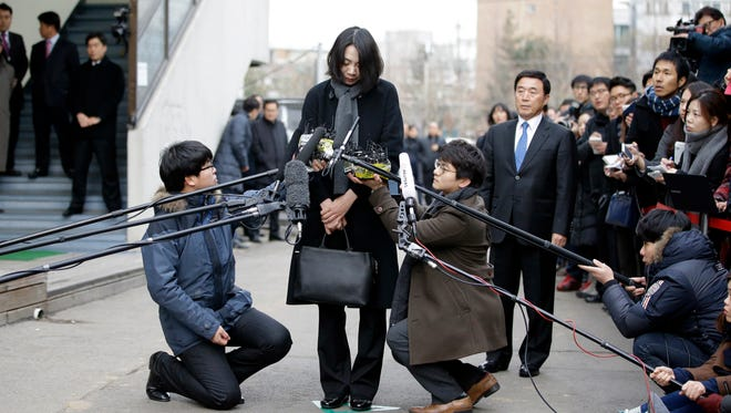 "Cho Hyun-ah, who was head of cabin service at Korean Air and the oldest child of Korean Air chairman Cho Yang-ho, speaks to the media upon her arrival for questioning at the Aviation and Railway Accident Investigation Board office of Ministry of Land, Infrastructure and Transport in Seoul, South Korea, Friday, Dec. 12, 2014. The chairman of Korean Air Lines apologized Friday for the behavior of his adult daughter who delayed a flight in an incident now dubbed ""nut rage."""