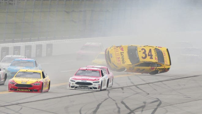 Chris Buescher (34) barrel rolls down the backstretch  during the May 1, 2016  Sprint Cup Series race at  Talladega Superspeedway.
