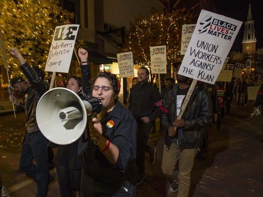 Demonstrators march against racism Thursday in Burlington.