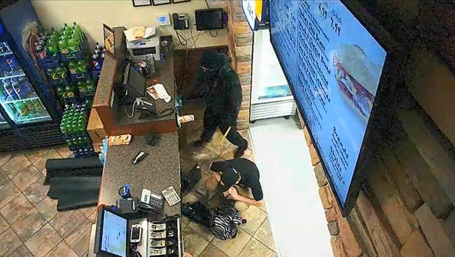 From video surveillance of a pizza shop robbery on Tiny Town Road July 8 in Clarksville.