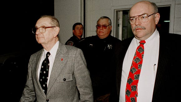 Byron De La Beckwith, left, is escorted from the Hinds