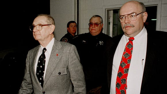 Byron De La Beckwith, left, is escorted from the Hinds County Courthouse in Jackson, Miss., by Sheriff Malcolm McMillin, right, and a deputy following his Feb. 5, 1994, conviction for the murder of NAACP leader Medgar Evers in 1963, following two previous mistrials in 1964.