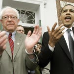 In this March 10, 2006, file photo, then-Sen. Barack Obama speaks at a Democratic rally for then-U.S. Rep. Bernie Sanders, left, in Burlington, Vermont. During a speech last week, Obama seemed less enthusiastic about Sanders as a presidential candidate.