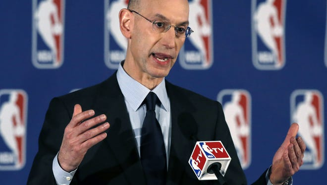 NBA Commissioner Adam Silver addresses a news conference in New York Tuesday.  Silver announced that Los Angeles Clippers owner Donald Sterling has been banned for life by the league in response to racist comments the league says he made in a recorded conversation.