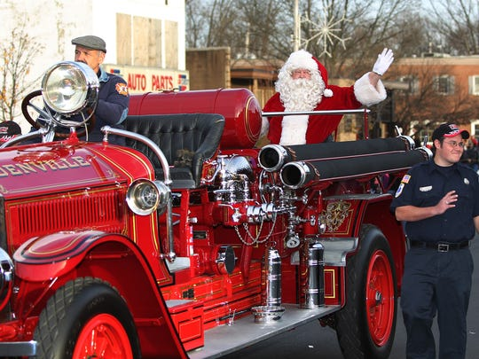 Santa waving during the 2011 Denville holiday parade.