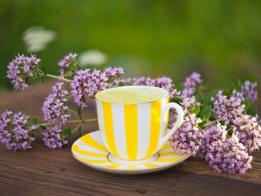 delicious  oregano tea in a beautiful glass bowl on table