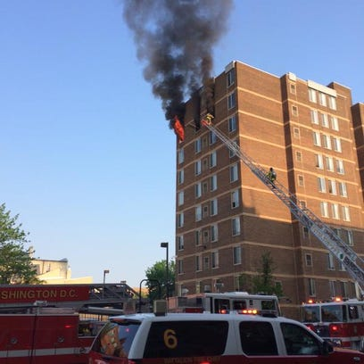 Fire shows from top floor of 9-story apartment building