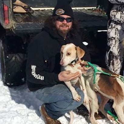 Chad Crane holds his dog Ghost. Ghost was shot in December