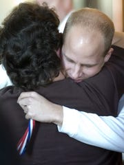 Rhonda Summers' son Jacob Hawk receives a hug Nov.