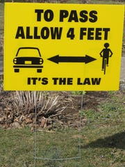 Pennsylvania law requires motorists to leave four feet for cyclists when passing.