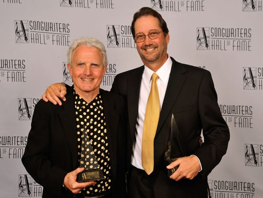 Tom Kelly, right, and Billy Steinberg, attend the Songwriters
