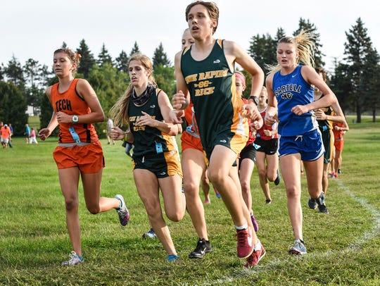 Runners take a corner in the St. Cloud Apollo Invitational