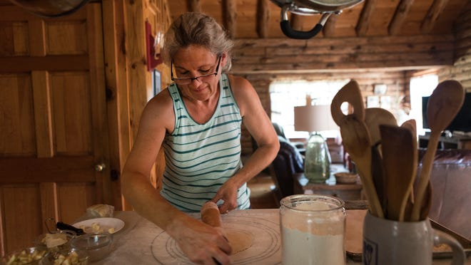 Kathy Goonan, owner of Log Cabin Backers, bakes hand-pies made with apple filling in her home in Plymouth.