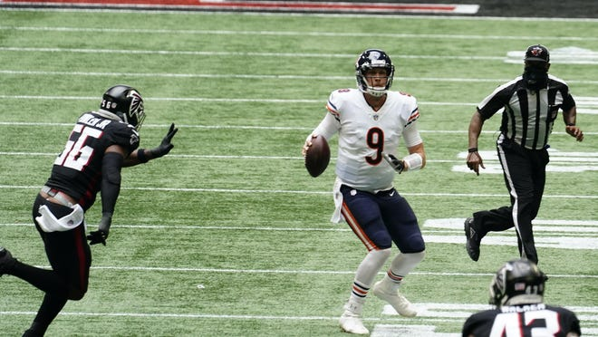 Chicago Bears quarterback Nick Foles (9) works against the Atlanta Falcons during the second half of an NFL football game, Sunday, Sept. 27, 2020, in Atlanta.