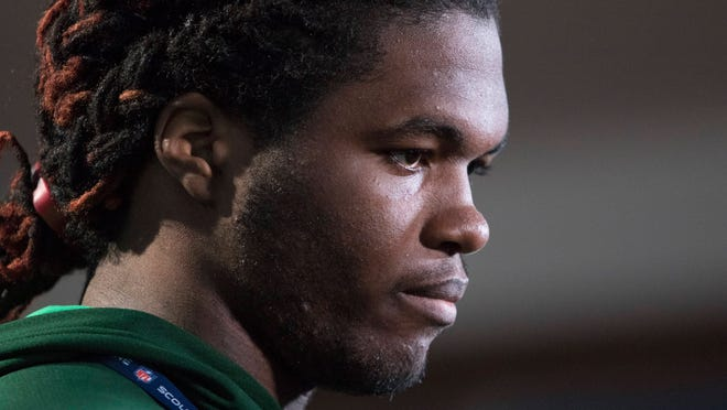 Louisville linebacker Lorenzo Mauldin speaks at the NFL combine in Indianapolis.