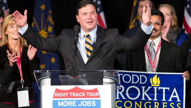 Republican congressman-elect, Todd Rokita, middle, speaks to a crowd at Lucas Oil Stadium, Indianapolis, Ind., Tuesday, November 6, 2012.
