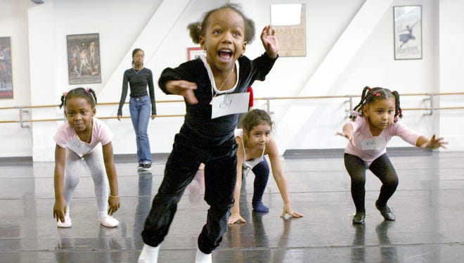 A group of young ballerinas in the 3 to 5 year age group jump like frogs during an audition for the Dance Theatre of Harlem's School spring 2004 semester, Sunday, Jan. 25, 2003 in New York.