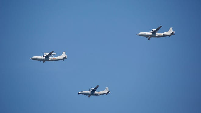 "In this Sept. 3, 2015 file photo, a KJ-200 airborne early warning and control plane, left, a Y-8J radar plane, center, and a Y-9JB radar plane, right, fly in formation during a parade commemorating the 70th anniversary of Japan's surrender during World War II in Beijing. The U.S. Pacific Command says a Chinese aircraft and a U.S. Navy patrol plane had an ""unsafe"" encounter over the South China Sea this week, raising concerns. Pacific Command spokesman Robert Shuford said Friday, Feb. 10, 2017, that the ""interaction"" between a Chinese KJ-200 early warning aircraft and a U.S. Navy P-3C plane took place on Wednesday, Feb. 8, in international airspace over the waters."
