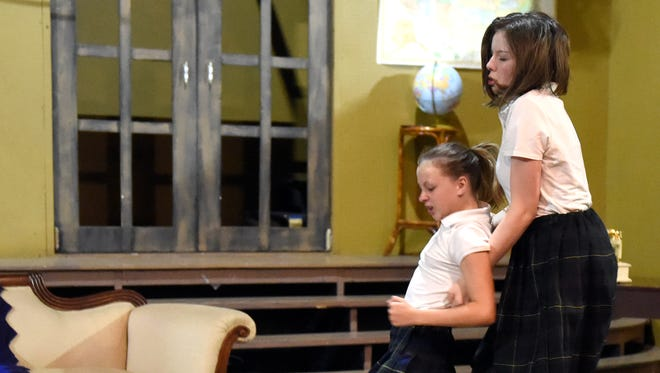 "Hailey Harper (left) Alyssa Chaffee (center) and Nadia Scharf rehearse a fight scene as the cast of ""Children's Hour"" at D'Alto studio."
