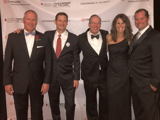 From left, 2017 Man of the Year winner Rick Blaiklock, 2016 Man of the Year winner Dan Goodrich, 2015 Man of the Year winner Mark Barnhart, 2014 Woman of the Year winner Julie Fecht, and Man of the Year runner-up Tom McCord, pose together at a Leukemia & Lymphoma Society gala in Indianapolis in 2017. The five, along with 2018 Man of the Year winner Rob Chinsky (not pictured), all have ties to Carmel's hockey community and in six years, have raised more than $1 million for blood cancer research.