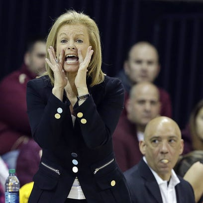Florida State coach Sue Semrau yells during the first