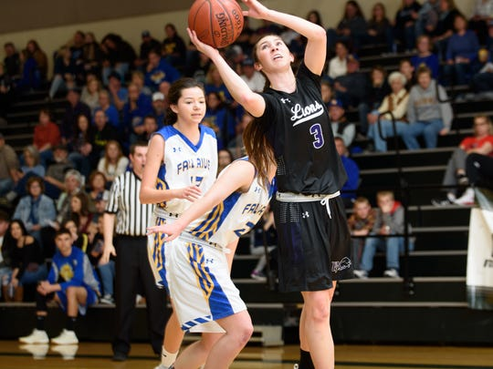 Redding Christian's Livi Lindsey, right, goes up for a shot Saturday in the NSCIF Division VI championship. Lindsey scored 17 points to lead Redding Christian in the loss.