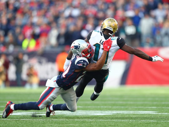 New England Patriots cornerback Malcolm Butler (21) breaks up a pass intended for Jacksonville Jaguars wide receiver Marqise Lee (11) during the first quarter in the AFC Championship Game at Gillette Stadium on Jan. 21, 2018.