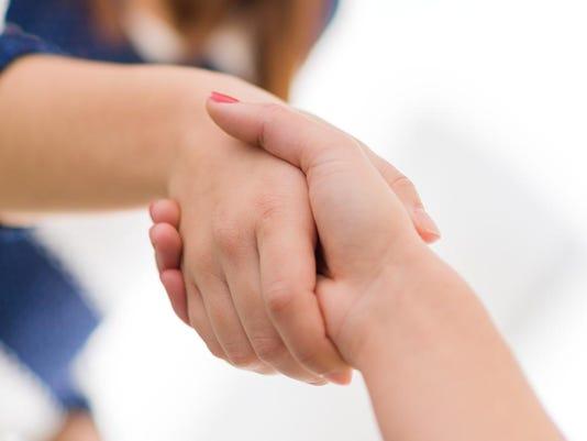 women shaking hands
