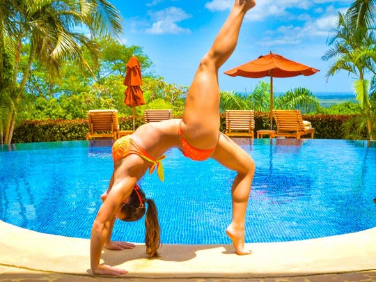 Collette Stohler does a back bend, poolside, in Tamarindo, Costa Rica.