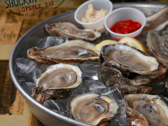 Shuckin' Shack is known for its seafood, its beach