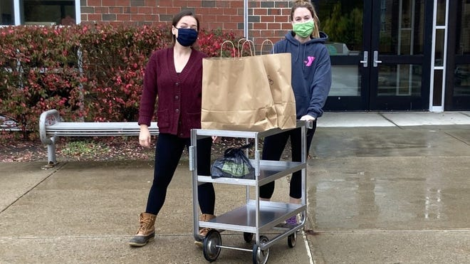 King Philip Director of Health Innovations Mary Kate Bergen and Hockomock Y volunteer Kayla Dunn at a recent meals drop-off.