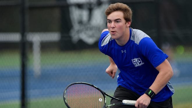 St. Joseph's tennis player Mack Self, above, asked a few of the school's year-round players to join the high school team, and the Knights have taken off. They're 10-0 entering the playoffs.