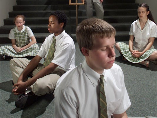 DIRECTOR OF MAHARISHI SCHOOL OF AGE AND ENLIGHTENMENT WATCHES AS STUDENTS MEDITATE