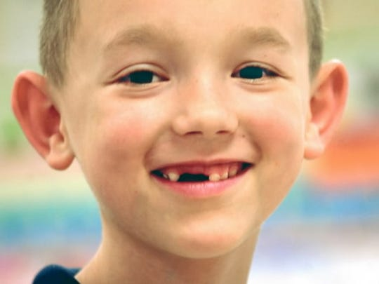 I June 2005, Mason Reyes lost two of his front teeth and was rewarded with a visit from the tooth fairy. (DAILY RECORD/SUNDAY NEWS -- FILE)