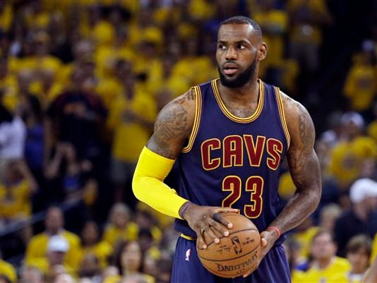 FILE - This June 14, 2015 file photo shows Cleveland Cavaliers forward LeBron James (23) playing against the Golden State Warriors during the first half of Game 5 of basketball's NBA Finals in Oakland, Calif.