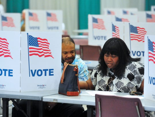 Patrick and Vernoica Thomas vote together in Montana's