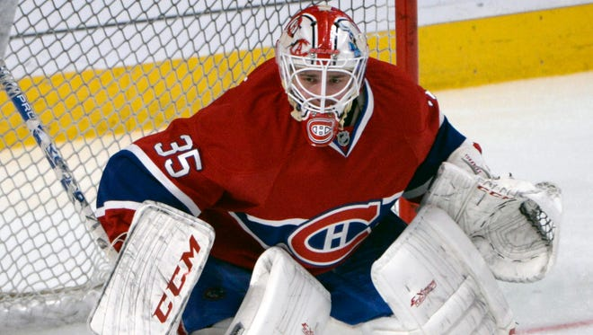 Montreal Canadiens goalie Dustin Tokarski warms up before making his NHL playoff debut in Game 2.