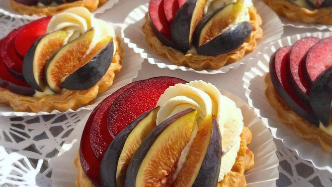 The Flaky Tart's fig, plum and Armagnac cream tartlets are made from pastry shells filled with Armagnac custard and topped with fresh figs, plums and pink peppercorn chantilly cream.