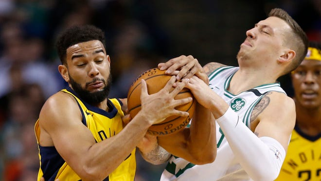 Pacers point guard Cory Joseph (6) rips the ball away from Boston Celtics forward Daniel Theis (27) during the first half at TD Garden.