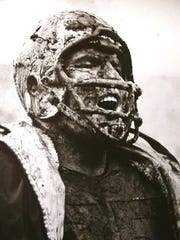 Packers offensive tackle Forrest Gregg cheers a good play by Green Bay's defense while covered in mud in a game against the San Francisco 49ers at Kezar Stadium on Dec. 10, 1960.