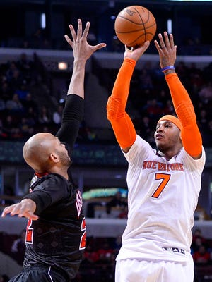 Carmelo Anthony, right, may be more interested in the Bulls if Taj Gibson is kept.