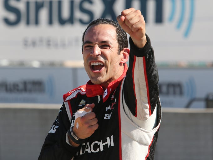 Helio Castroneves celebrates after winning the second race of the IndyCar Detroit Grand Prix auto racing doubleheader in Detroit Sunday, June 1, 2014