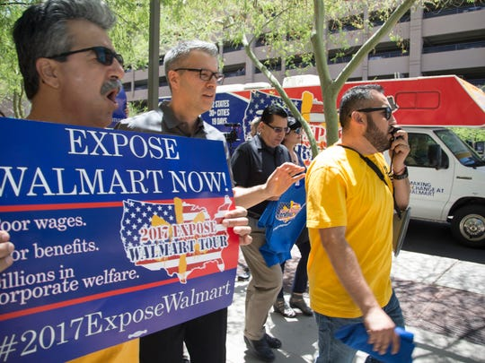 Oscar Aragon leads a protest against Walmart, May 15,