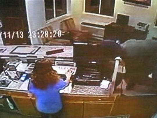 A security camera image shows a man suspected of assaulting