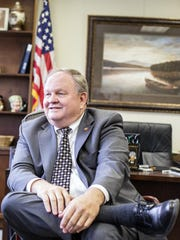 Rep. Chuck McGrady, R-Henderson, sits in his office at the North Carolina General Assembly earlier this year.