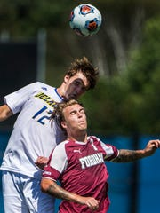 Delaware's Soren Forest (No. 12) goes up for a header over Fordham's Jannik Loebe (No. 7) in the first half of Delaware's 1-0 win over Fordham at Grant Stadium at the University of Delaware on Sunday afternoon.